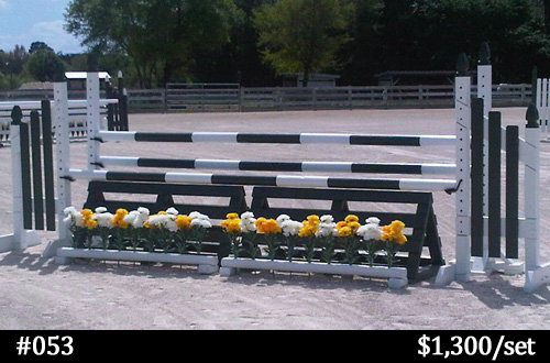 green and white horse jump with flower box