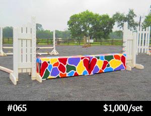 rainbow-colored stone child horse jump