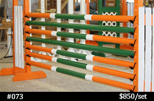 orange, green, and white horse jump poles