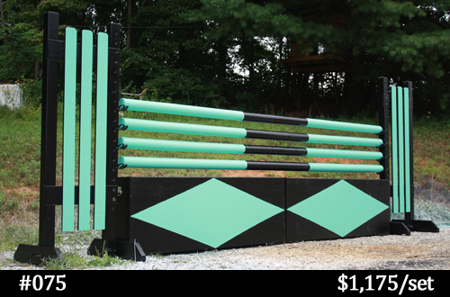 black and teal horse jump standards, poles, and wall