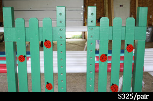 green horse jump standards with lady bugs