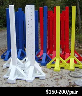 white, blue, yellow and red horse jump standards